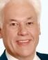 Portrait Prof. Dr. Günter Dhom, Privatklinik Vitalitas, Abteilung Ästhetische Zahnheilkunde, Implantologie, Neustadt, Zahnarzt, MKG-Chirurg, Oralchirurg