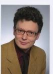 Portrait Sacha Karmoll, Zahnarzt, Tätigkeitsschwerpunkte Akupunktur, Parodontologie und computergestützte vollkeramische Restaurationen, Freudenstadt, Zahnarzt