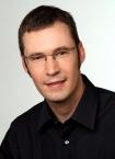 Portrait Dr. Sven Schweitzer MSc, Praxis für Oralchirurgie und Implantologie, Berlin, Zahnarzt, Oralchirurg, Master of Science Implantologie
