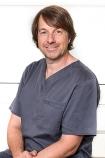 Portrait Dr. med. dent. Claudio Cacaci, Implantat Competence Centrum München, Praxis für Implantologie und Parodontologie Dr. Cacaci & Dr. Randelzhofer, München, Zahnarzt, Oralchirurg, Fachzahnarzt für Oralchirurgie und Implantologie